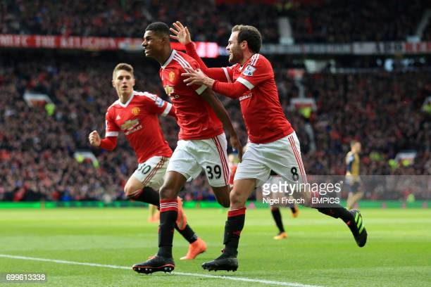Manchester United's Marcus Rashford celebrates scoring his side's first goal of the game with team mate Juan Mata