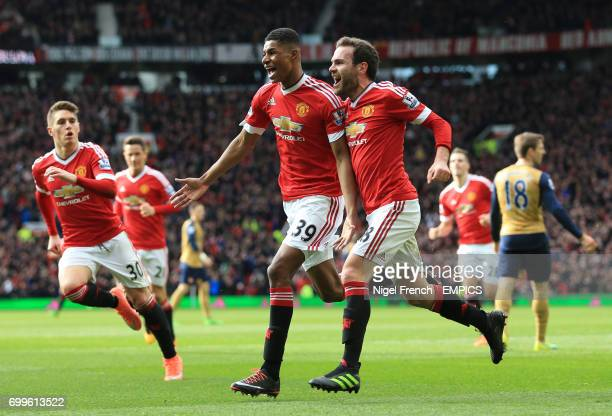 Manchester United's Marcus Rashford celebrates scoring his side's first goal of the game with team mates Guillermo Varela and Juan Mata
