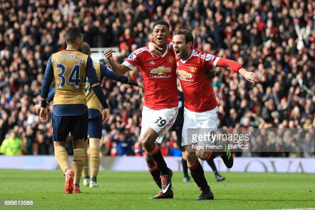 Manchester United's Marcus Rashford celebrates scoring his side's first goal with team mate Juan Mata