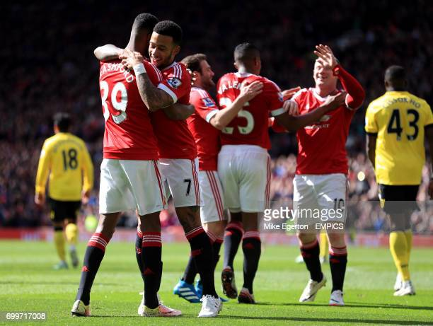 Manchester United's Marcus Rashford celebrates scoring his side's first goal of the game with Memphis Depay