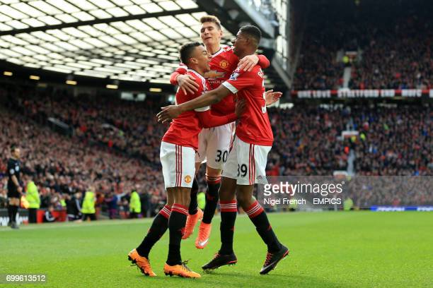 Manchester United's Marcus Rashford celebrates scoring his side's second goal of the game with team mates Jesse Lingard and Guillermo Varela