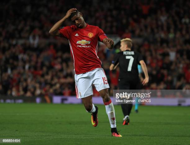 Manchester United's Marcus Rashford holds his head after a near miss