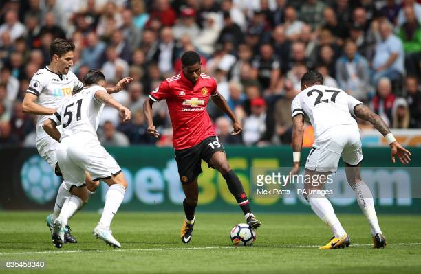 Manchester United's Marcus Rashford in action against the Swansea City defence during the Premier League match at the Liberty Stadium Swansea