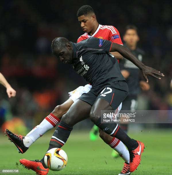Manchester United's Marcus Rashford Liverpool's Mamadou Sakho battle for the ball