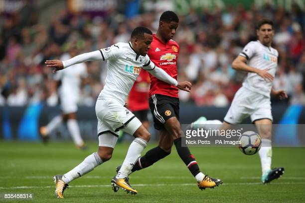 Manchester United's Marcus Rashford misses a chance under pressure from Swansea City's Martin Olsson during the Premier League match at the Liberty...