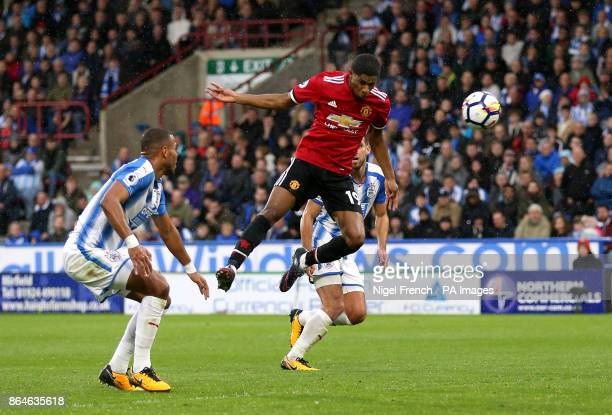 Manchester United's Marcus Rashford scores his side's first goal of the game during the Premier League match at the John Smith's Stadium Huddersfield