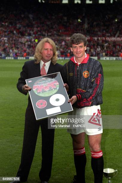 Manchester United's Mark Hughes with Rick Parfitt of Status Quo with a Gold Disc for the song Manchester United released with Status Quo 'Come on You...