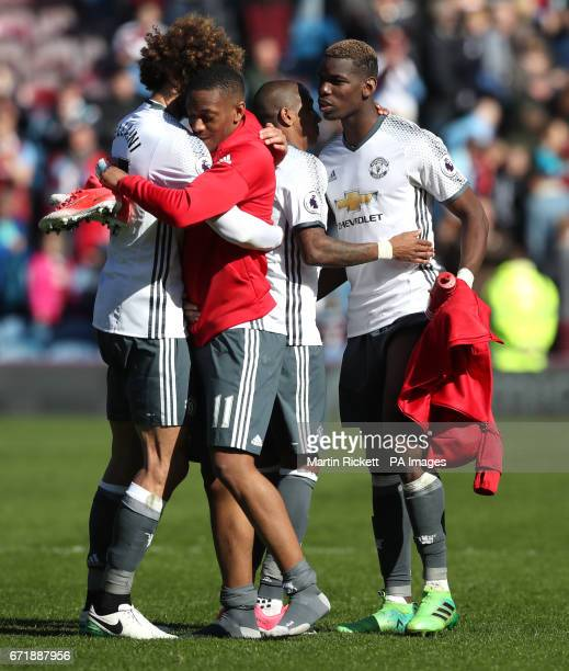Manchester United's Marouane Fellaini and Anthony Martial embrace after the final whistle the Premier League match at Turf Moor Burnley