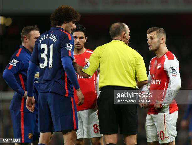 Manchester United's Marouane Fellaini and Arsenal's Jack Wilshere argue with referee Mike Dean after a altercation