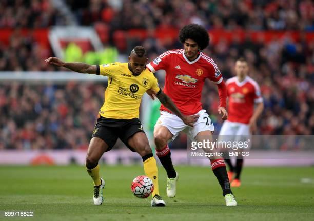 Manchester United's Marouane Fellaini and Aston Villa's Leandro Bacuna battle for the ball