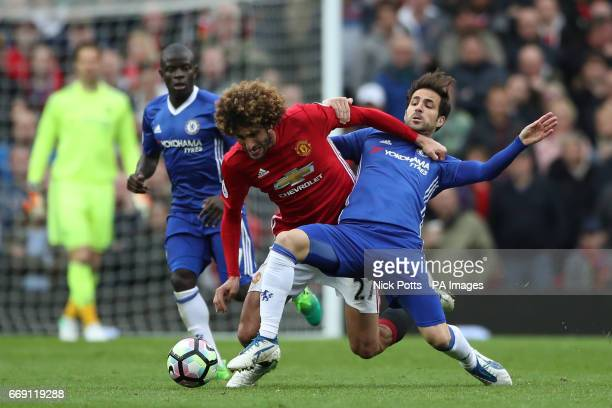 Manchester United's Marouane Fellaini and Chelsea's Cesc Fabregas battle for the ball during the Premier League match at Old Trafford Manchester
