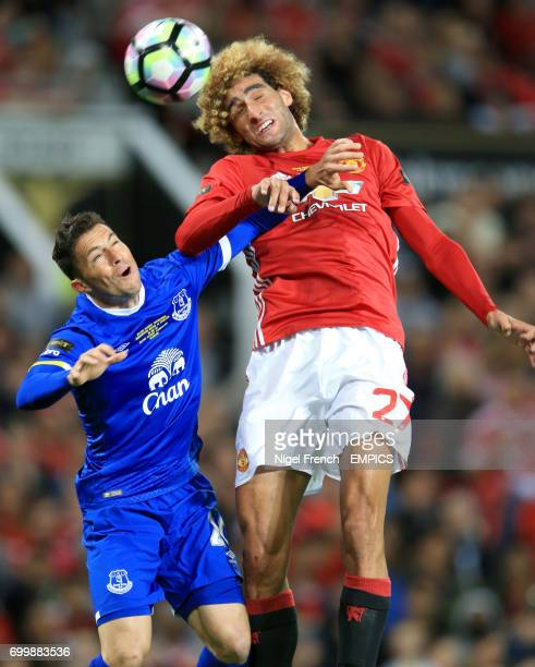 Manchester United's Marouane Fellaini and Everton's Bryan Oviedo battle for the ball in the air