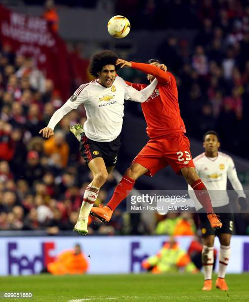 Manchester United's Marouane Fellaini and Liverpool's Emre Can battle for the ball in the air
