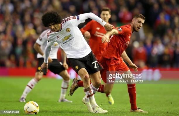 Manchester United's Marouane Fellaini and Liverpool's Jordan Henderson battle for the ball
