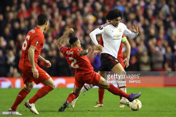 Manchester United's Marouane Fellaini and Liverpool's Nathaniel Clyne in action