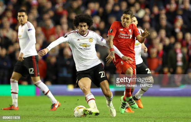 Manchester United's Marouane Fellaini and Liverpool's Roberto Firmino battle for the ball