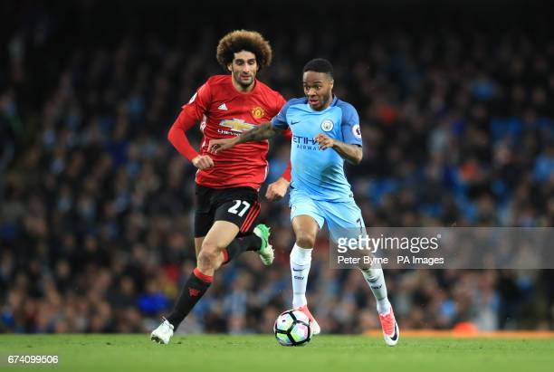 Manchester United's Marouane Fellaini and Manchester City's Raheem Sterling battle for the ball during the Premier League match at the Etihad Stadium...