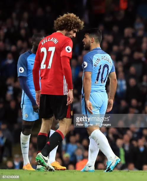 Manchester United's Marouane Fellaini and Manchester City's Sergio Aguero square up to each other during the Premier League match at the Etihad...