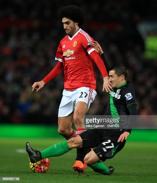 Manchester United's Marouane Fellaini and Stoke City's Bojan Krkic battle for the ball