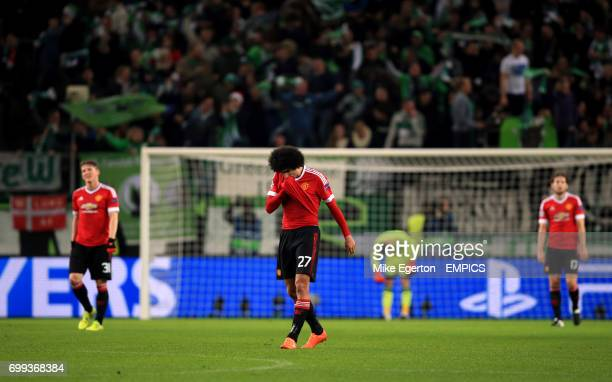 Manchester United's Marouane Fellaini appears dejected