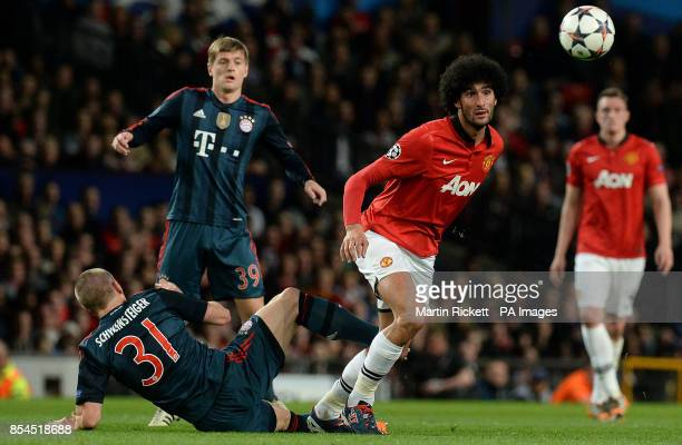 Manchester United's Marouane Fellaini battles for the ball with Bayern Munich's Bastian Schweinsteiger during the UEFA Champions League Quarter Final...