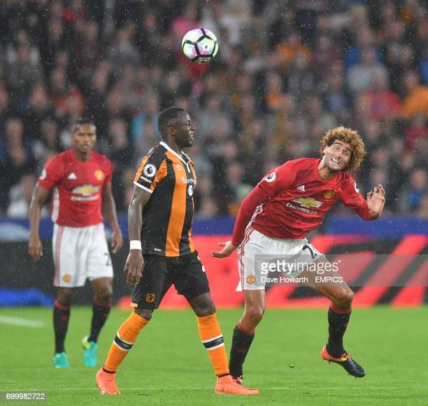Manchester United's Marouane Fellaini battles with Hull City's Adama Diomande