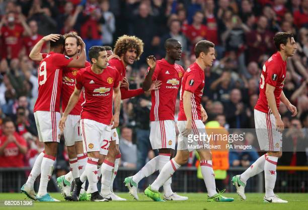 Manchester United's Marouane Fellaini celebrates scoring his side's first goal of the game with teammates during the UEFA Europa League Second Leg...