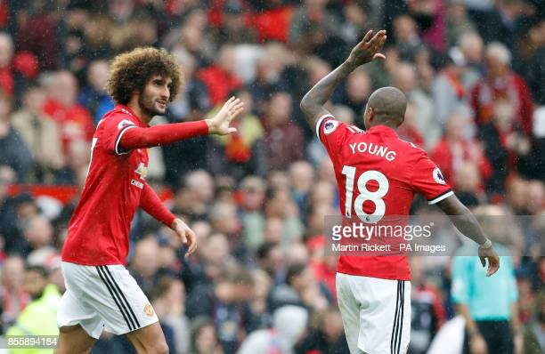 Manchester United's Marouane Fellaini celebrates scoring his side's third goal of the game with Ashley Young during the Premier League match at Old...