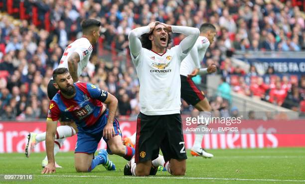 Manchester United's Marouane Fellaini reacts after missing a chance on goal