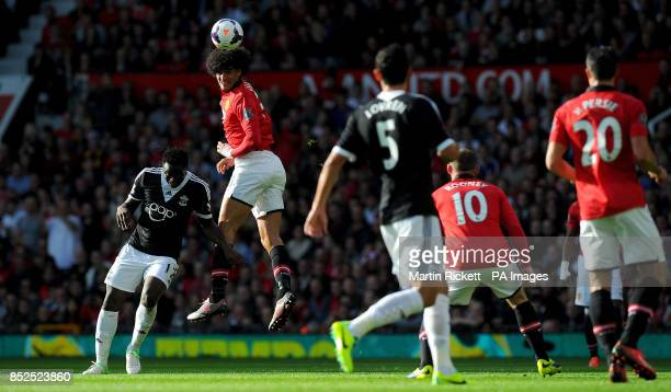 Manchester United's Marouane Fellaini wins a header over Southampton's Victor Wanyama during the Barclays Premier League match at Old Trafford...