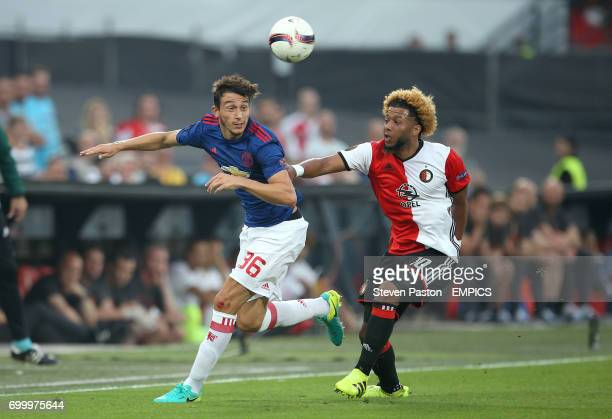 Manchester United's Matteo Darmian and Feyenoord's Tony Vilhena battle for the ball