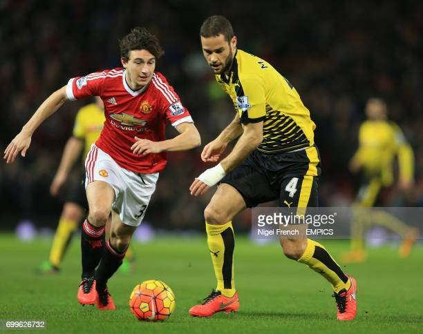 Manchester United's Matteo Darmian and Watford's Mario Suarez battle for the ball