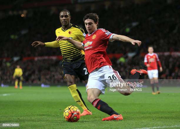 Manchester United's Matteo Darmian and Watford's Odion Ighalo battle for the ball