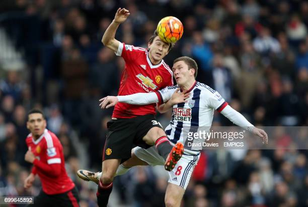 Manchester United's Matteo Darmian and West Bromwich Albion's Craig Gardner battle for the ball in the air