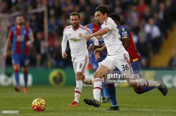 Manchester United's Matteo Darmian battles for the ball