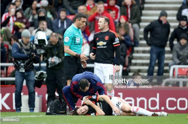 Manchester United's Matteo Darmian lies injured