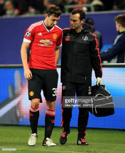 Manchester United's Matteo Darmian limps off injured