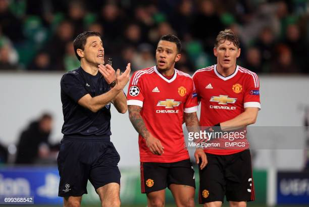Manchester United's Memphis Depay and Bastian Schweinsteiger appeal to the referee Milorad Mazic after he disallows a goal