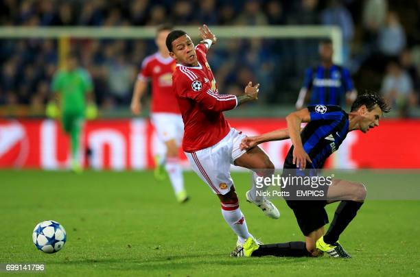 Manchester United's Memphis Depay and Club Brugge's Davy De fauw in action
