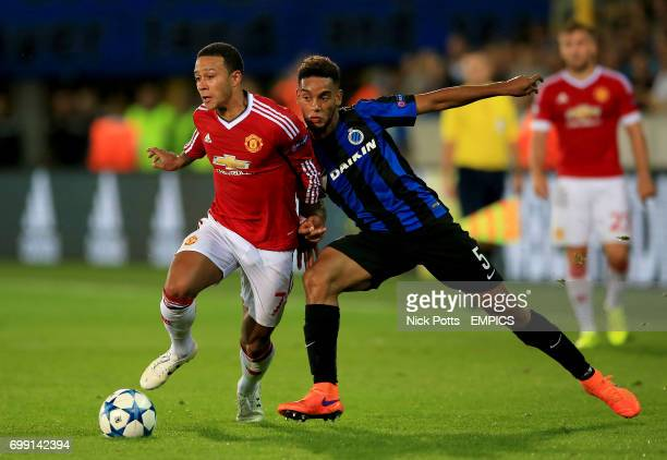 Manchester United's Memphis Depay and Club Brugge's JeanCharles Castelletto battle for the ball