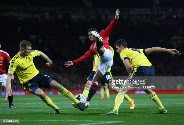 Manchester United's Memphis Depay and Middlesbrough's Daniel Ayala battle for the ball