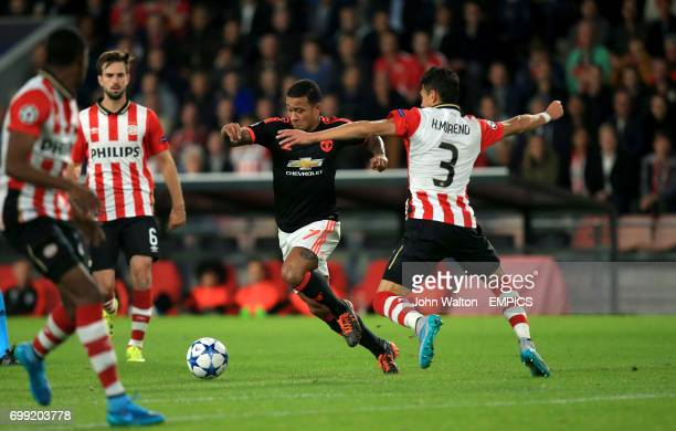 Manchester United's Memphis Depay and PSV Eindhoven's Hector Moreno battle for the ball