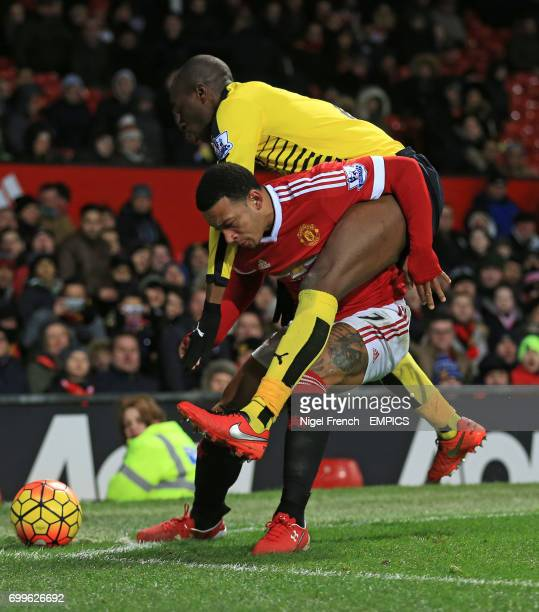 Manchester United's Memphis Depay and Watford's AllanRomeo Nyom battle for the ball