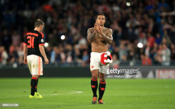 Manchester United's Memphis Depay applauds the fans after the match