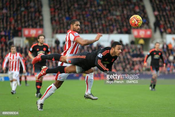 Manchester United's Memphis Depay attempts to head the ball back to his goalkeeper before Stoke City's Glen Johnson collects the ball leading to the...