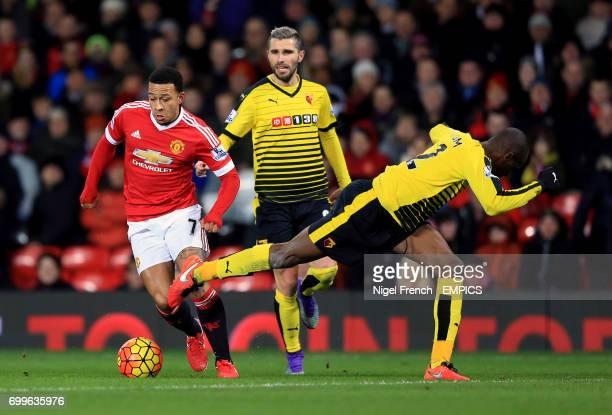 Manchester United's Memphis Depay gets past Watford's AllanRomeo Nyom