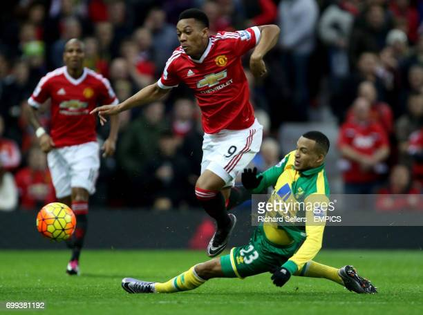 Manchester United's Memphis Depay is challenged by Norwich City's Martin Olsson