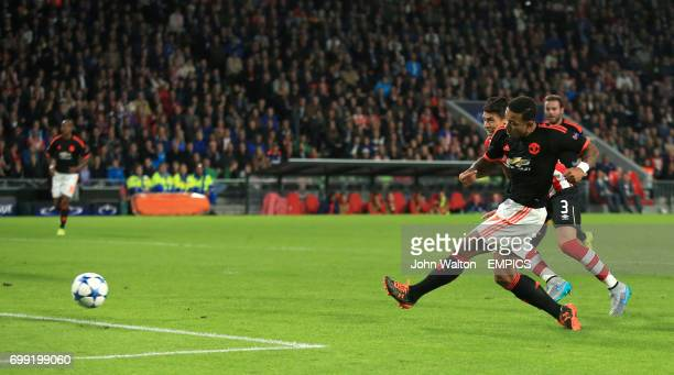 Manchester United's Memphis Depay scores his side's first goal of the game