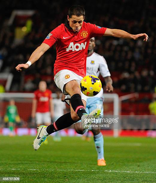 Manchester United's Mexican forward Javier Hernandez controls the ball during the English Premier League football match between Manchester United and...