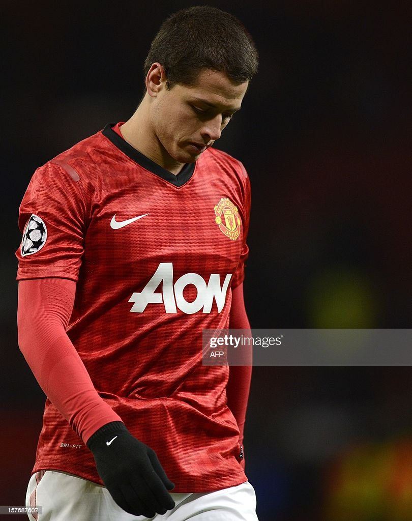 Manchester United's Mexican forward Javier Hernández leave's the pitch after the 1-0 defeat to CFR Cluj-Napoca during the UEFA Champions League group H football match between Manchester United and CFR Cluj-Napoca at Old Trafford in Manchester, north-west England, on December 5, 2012.
